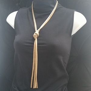 Gold slip knot statement necklace.